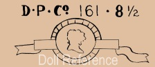 Diamond Pottery Company doll mark DPCo. 161 head on ribbon symbol