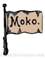 Moses Kohnstam doll mark MOKO on a flag