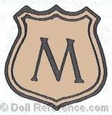 Mechanical Rubber Co doll mark M on a shield 1917+