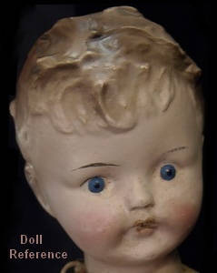 "Composition American doll 14"", painted eyes, curly molded hair, cloth body"