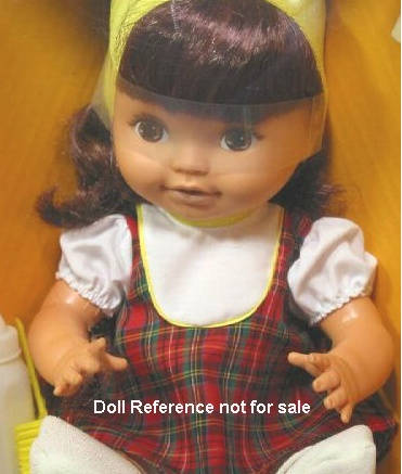 Shindana Little Girl doll plaid dress, mid 1960s