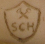 Schmitt et Fils doll mark, crossed hammers on a shield, initials SCH