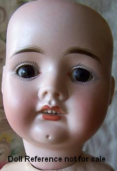 "Recknagel bisque Dolly Face doll, 21"" tall"